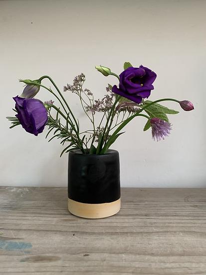 Flat top bud vase. Black glazed