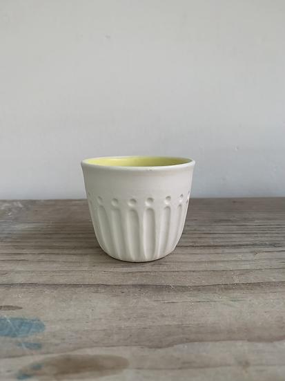 Carved porcelain beaker yellow inside
