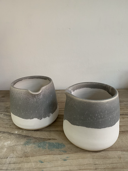 Small grey white pourer