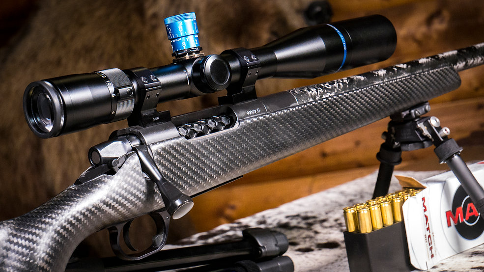 Huskemaw 4.16x42 on rifle.jpg