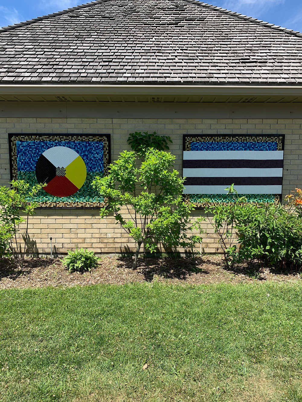 Glass Medicine Wheel and Glass Two Row Wampum by Brenda Collins installed at the London Tourism Welcome Centre