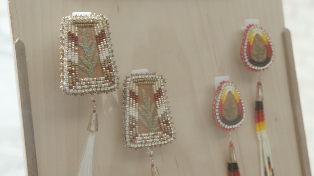 Two sets of beaded earrings displayed