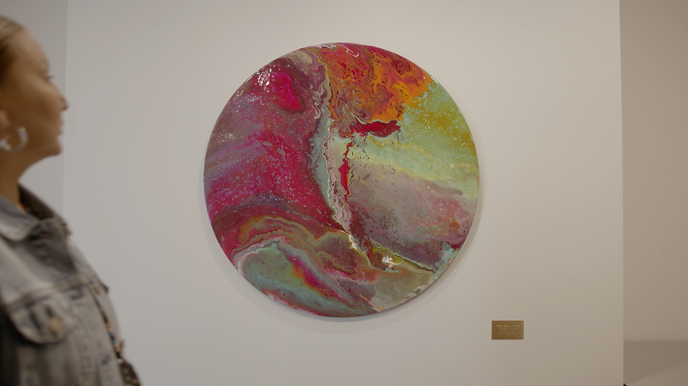 A circular abstract painting called Oscar Marroquin-Ponce