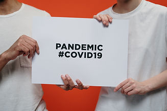 people-holding-white-paper-with-pandemic