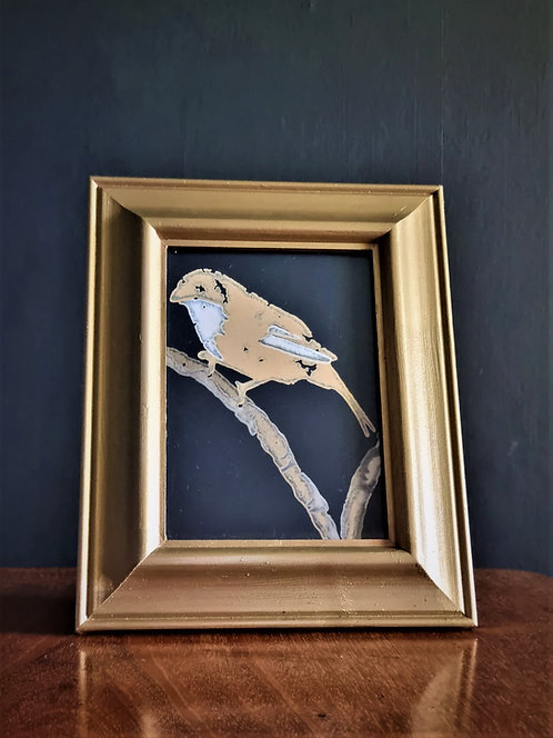 Framed bird on a perch picture