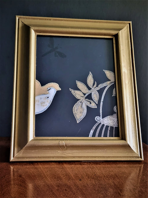 Framed bird out of the cage picture