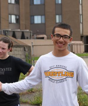 CE boy smiling with wrestling shirt.JPG