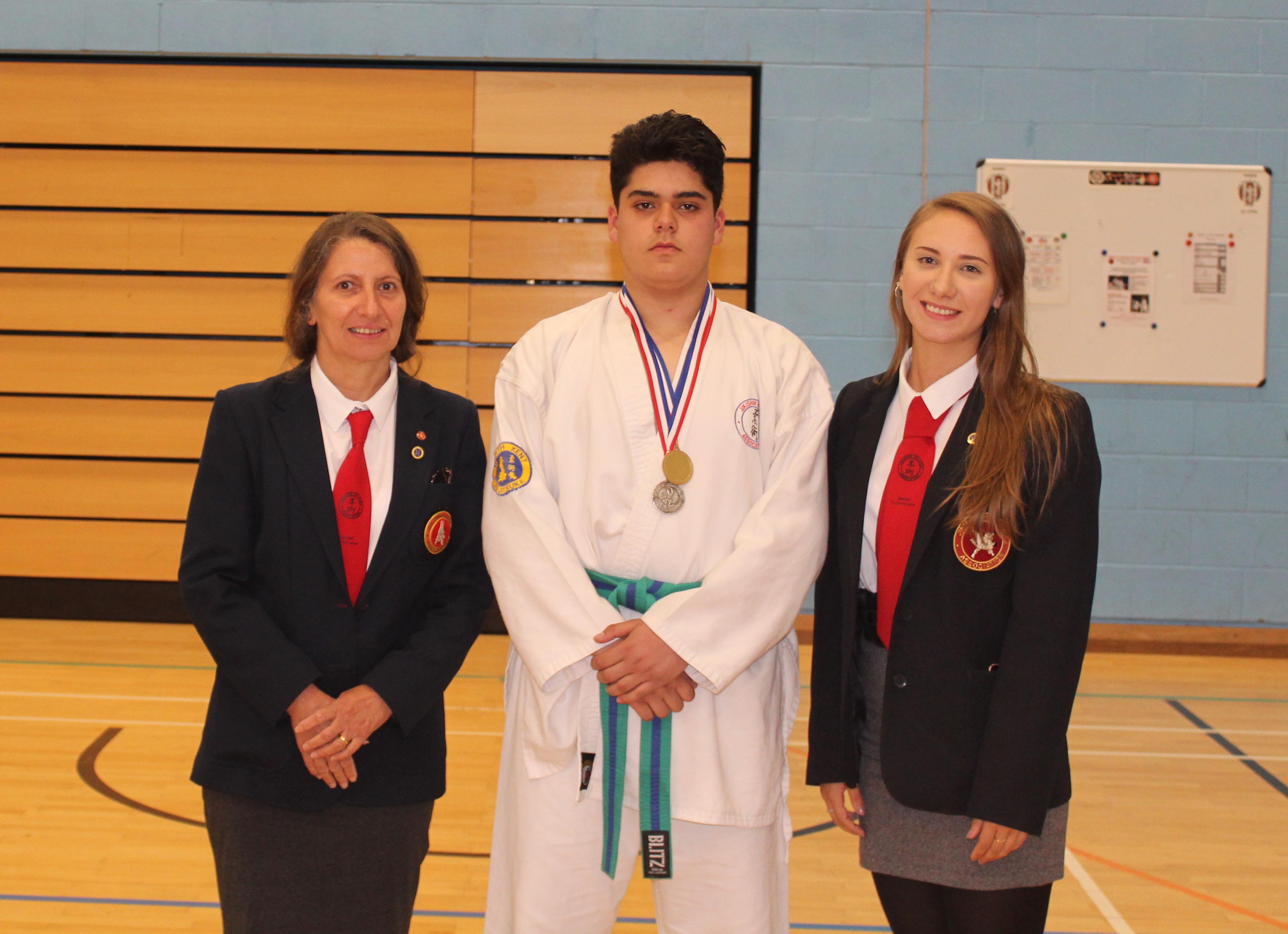 North Kent Ju-Jitsu Kai student winning silver and gold medals