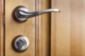 Modern style door handle on natural wood