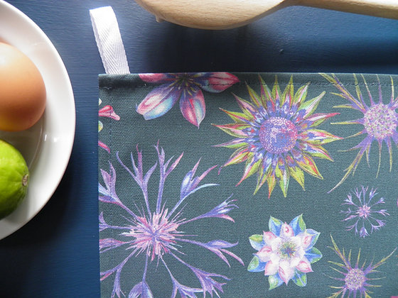 Beautiful floral cotton tea towel, with happy pink, blue, green, blue and purples. Hand Drawn and made in England.