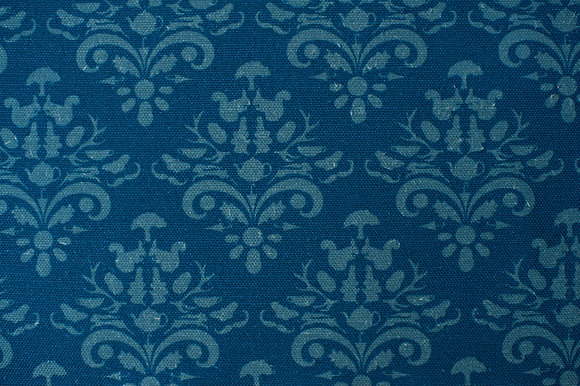 Willis Bloom How Very British fabric in Indigo blue. Classic design with a quirky twist for people that love pattern.