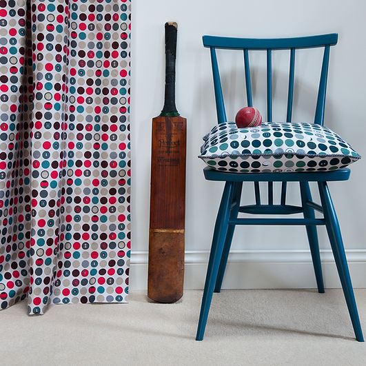 Willis Bloom Dotty about Buttons fabric. Shown as cutains in Carnival colourway and Harmony in Teal cushion. Beautiful homes, inspiring fabrics. Love pattern.