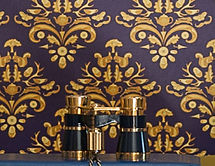 Willis Bloom How very british wallpaper in Midnight Crest. A deep blue, purple and gold coloued wallpaper. Bold and beautiful.