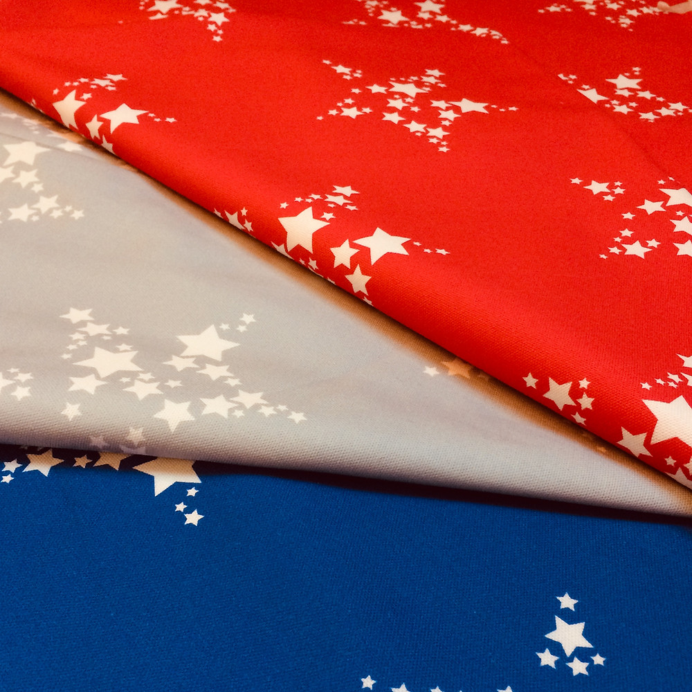 Star Bright Fabric collection by Willis Bloom in red, blue and silver