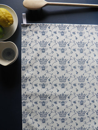 Beautiful floral bee tea towel, with a soft blue hand drawn design by Willis Bloom. Designed and made in Engalnd.
