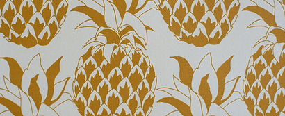 Willis Bloom pineapple wallpaper shown in Golden mist. Beatiful gold pineapple wallpaper inspiration for beautiful homes.
