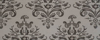 Willis Bloom How Very British wallpaper in Majestic mushroom. A warm grey wallpaper with a classic pattern.