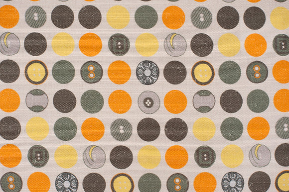 Willis Bloom Dotty About Buttons fabric in Dandelion and pebble. A yellow, orange and grey fabric for beautiful homes.