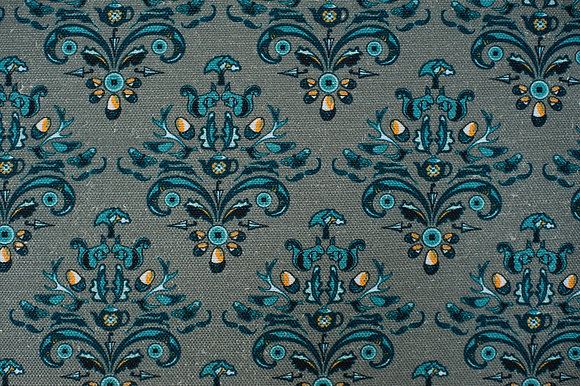 Willis Bloom How Very British fabric in Stately Teal blue. Classic design with a quirky twist for people that love pattern.