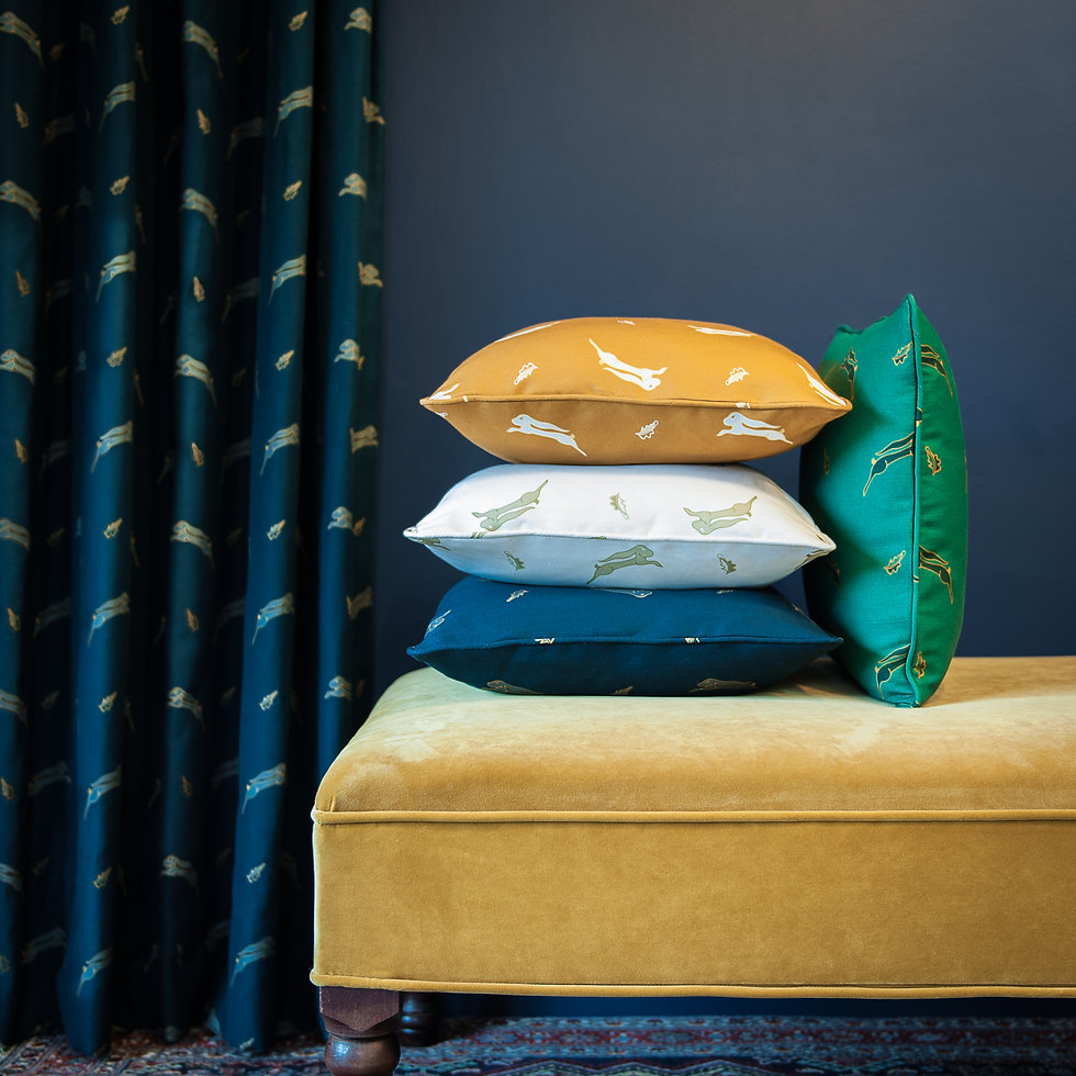 Whimsical Hare new fabric collection by Willis Bloom. Leaping Hares and oak leaves on a beautiful linen union in 4 striking colours. Cobalt Blue, Nettle Green, Burnt Sand (ochre / gold) and a natural Buttercream. Looks fabulous as curtains, blinds, cushions and lampshades.