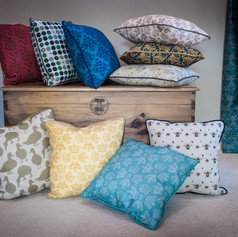 Group of Willis Bloom cushions.