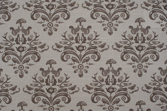 Willis Bloom How Very British fabric in majestic mushroom, warm grey. Classic design with a quirky twist.