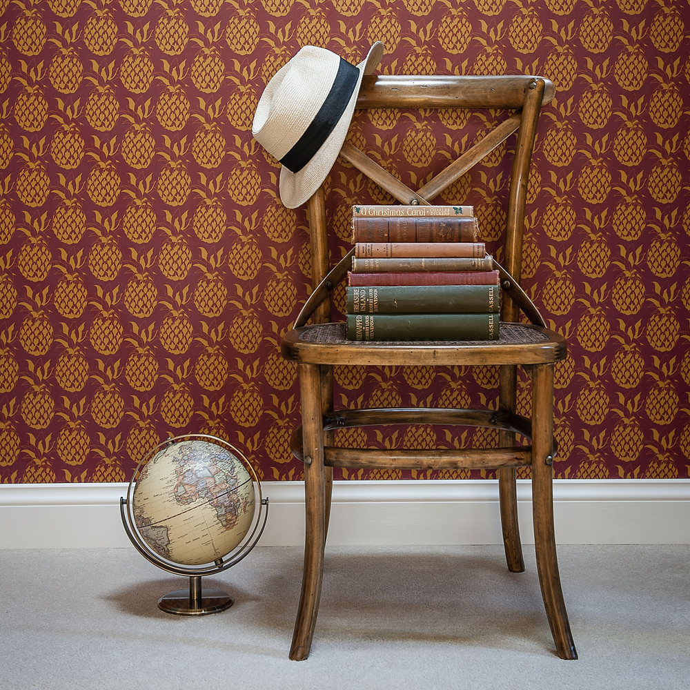 Willis Bloom Pineapple wallpaper as a lovely backdrop to some wonderful old books