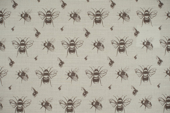 Willis Bloom Coal grey Bee fabric on a natural linen. Beautiful cushion and curtain inspiration.