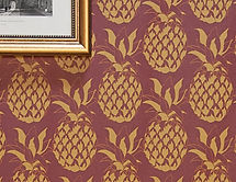 Willis Bloom pineapple wallpaper in Garnet. A gorgeous gold ad red combination to inspire your beautiful home.