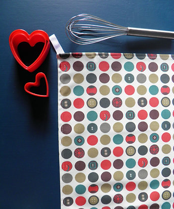 Dotty Tea Towel by Willis Bloom. Red, teal, blue dot for stylish beautiful homes and kitchens. Designed and made in England.