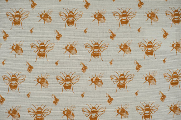 Willis Bloom Bee fabric for cushions and curtain with a rich gold print. Love pattern. Beautiful homes.