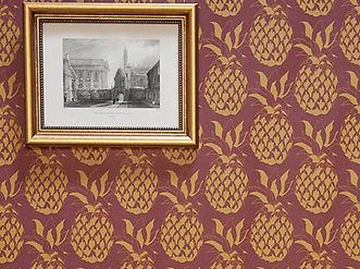 Willis Bloom Pineapple wallpaper in Garnet. Deep red and gold wallpaper inspiration.