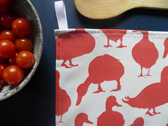 Ducks in red jam colour cotton kitchen tea towel by Willis Bloom. Hand drawn designs and made in England.