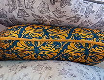 Willis Bloom Calla Lily fabric shown in a cushion, Midnight gold colourway. Beautiful home inspiration.
