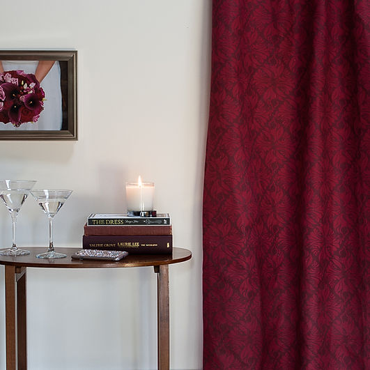 Willis Bloom Calla Lily fabric shown as curtains in Crimson Berry. Beuatiu Homes. Fabric inspiration.