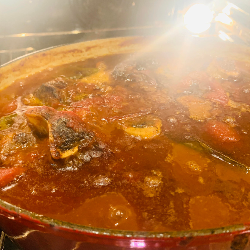 The pot is boiling venison osso buco, Cervo in pentola.