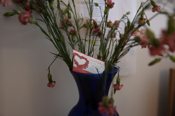 Flowers stand in a vase next to Audrey Schirmer's bed in her nursing home in Montreal. They were a Valentine's day gift from her husband Martin Duckworth.