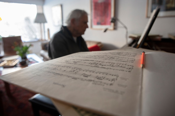 Martin Duckworth plays the piano at his friend's Nina Mende's house. He meets with a group of friends every Wednesday to play classical music.