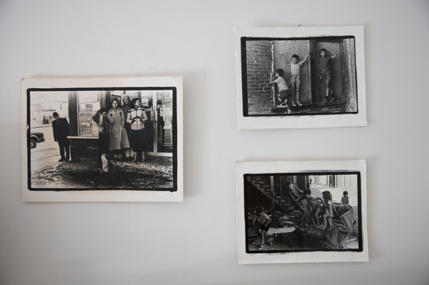 Audrey Schirmer's photographs hang on the wall of her room in her nursing home. Schirmer had a successful career as a photographer. The pictures on her wall depict the lives of young immigrant children in Montreal's Mile End neighbourhood in the 80s.