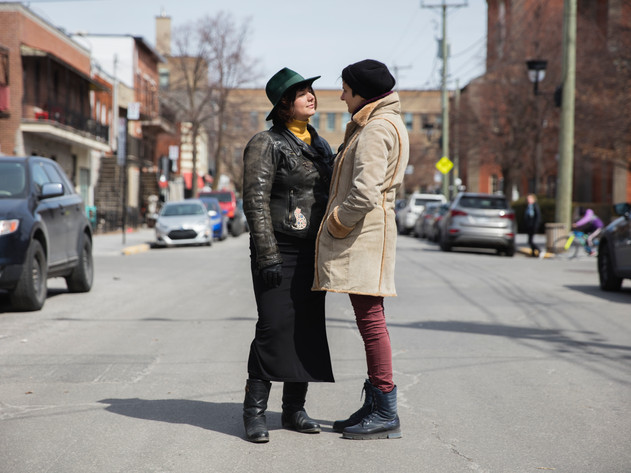 Léa Marinova and Eleonora look at each other before posing for a portrait on Dante street. Léa and Eleonora live a long-distance relationship between Sofia and Montreal.