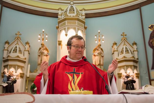 Priest Dariusz Szurko gives morning mass in the Holy Trinity Parish in Pointe-Saint-Charles.