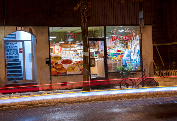 A car passes by the Batory Polish grocery store on Saint-Viateur street on November 28, 2018. Jadwiga Czerkawska opened the store with her husband Marek Witkowski in 1991. They had to leave Canada the following year because of immigration issues but came back in 1994 to continue their business. While they were gone, it is their friends who held the store.