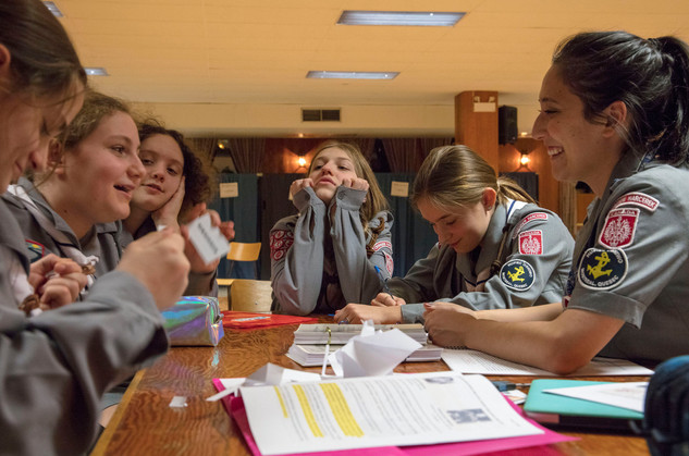 Emilia (center) listens while her fellow scouts participate in a word play activity. The girls meet on a bi-monthly basis in the basement of the Holy Trinity church in Pointe-Saint-Charles, Montreal to play games, learn about Polish history, sing songs and participate in scout related activities.