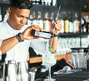 expert-bartender-pouring-alcohol-NMUPGB8