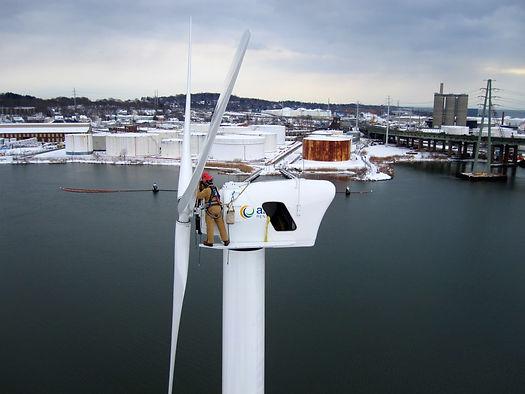 Aegis workers install wind turbine blades