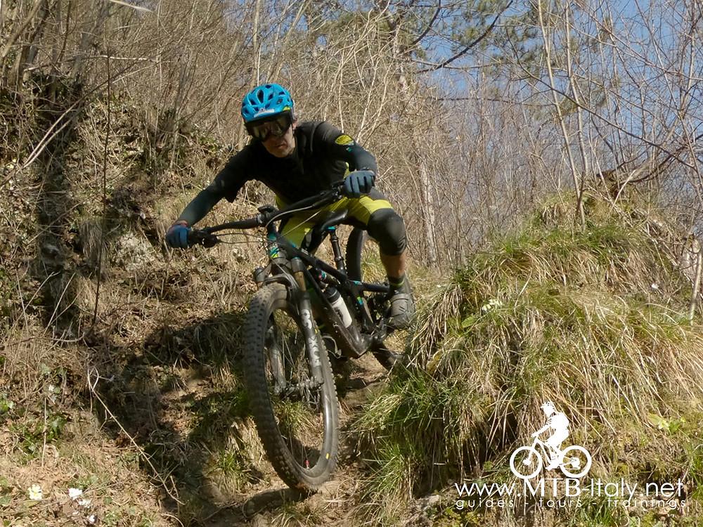 biker riding a mountain bike on steep strail
