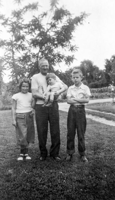 Paul with brother Doyle, cousin Marilyn, and paternal grandfather Eugene. Raytown, MO, circa 1952.