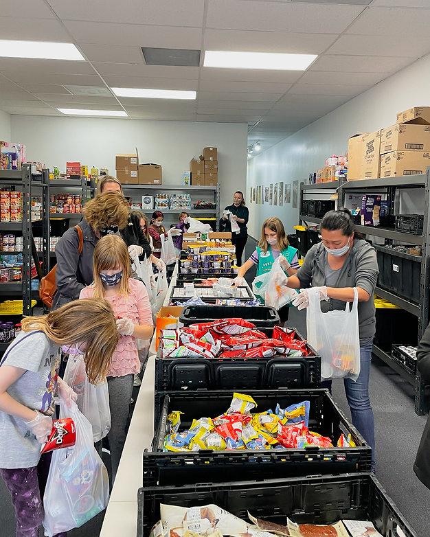 Volunteers packing bags.jpg