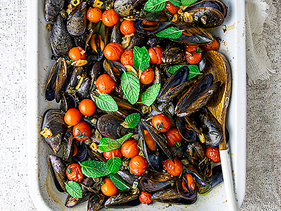Oven baked mussels with cherry tomatoes and capers