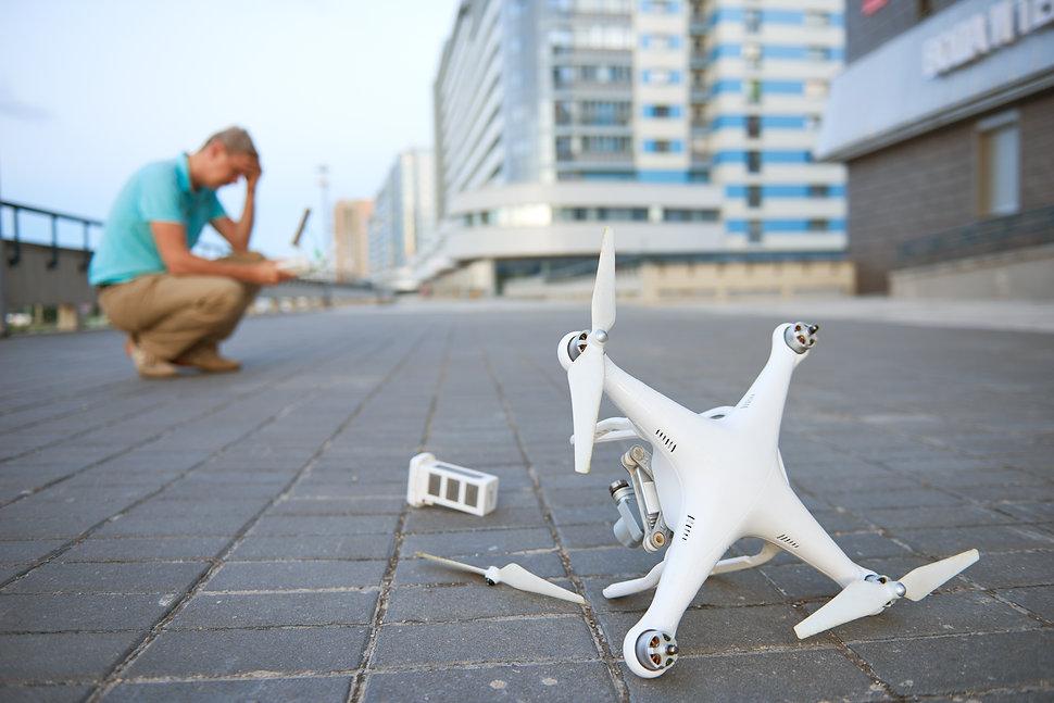 Drone crash. Fallen damaged quadrocopter